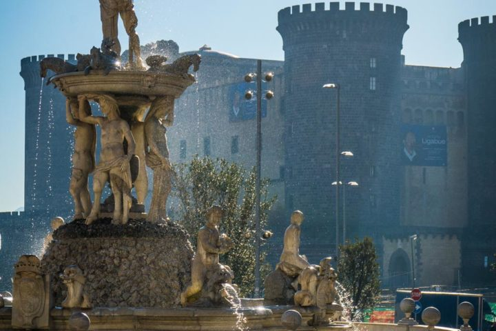 Highlights of Naples - Town Hall square fountain view with the New Castle