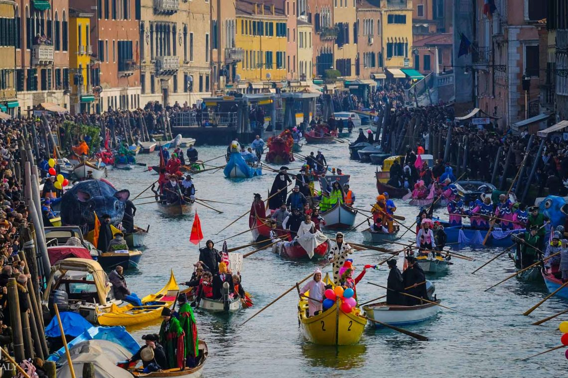 Venice Carnival in a canal